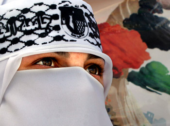 A Palestinian student wears a Fatah headband during a rally supporting the Palestinian President Mahmoud Abbas in the West Bank city of al-Khalil (Hebron) on March 13, 2005. Photo by/Nayef Hashlamoun